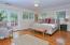 Master bedroom with French doors & garden views