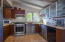 Remodeled Kitchen With Newer KitchenAid Refrigerator & Stove