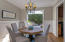 Formal dining room with French doors to back yard