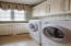 Laundry Room with cabinets and washer dryer included