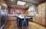 Kitchen with custom backsplash by local artist, walnut floors, designer appliances