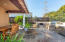 Fabulous top of the line outdoor kitchen w/sink, refrigerator, gas and Charcoal BBQs.