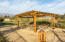 Large picnic area with pergola, several tables and two BBQ's. Huge play yard and excellent mountain view!