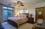 With spacious walk-in closet and sitting area leading to backyard