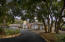 Lined with mature trees & ample parking