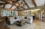 Vaulted ceilings, glass pocket doors & stone fireplace