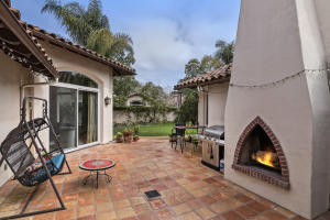The patio off of the family room is set up for entertaining with the BBQ, swing, fireplace and yard space.