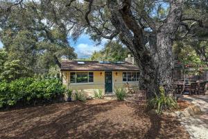 Charming partial adobe cottage set under majestic oaks.