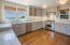 The remodeled kitchen enjoys head-on ocean views, and has marble counters and stainless appliances.
