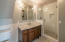 The en suite master bathroom features marble counters.