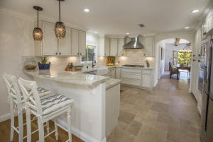 Bright, open kitchen fully furnished for those who love to cook.