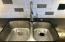 Stainless Steel Double Sinks, Garbage Disposal and Handsfree Pull-Down Faucet! Watch your guests try to figure out how the easy system works.