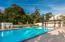 Amenities including pool, rose garden, tennis court, and more are yours to enjoy!