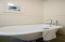 Brand new clawfoot soaking tub in newly finished bathroom.