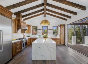 Thermador appliances, custom Walnut cabinetry, Clay subway tile & beautiful Quartz countertops w/a 10' waterfall island