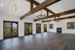White Oak floors, Milgard french doors & beautiful Black/Gold chandeliers