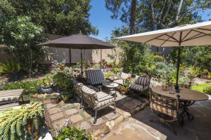 The townhome is one of the few that includes a private outdoor garden and sitting area.