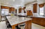 Chef's Kitchen with over-sized island, stainless appliances,