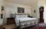 The Master Suite with a California King Bed! This room also has a gas fireplace, sky light and a walk in closet.