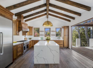 """Custom handmade Walnut cabinetry paired w/French Gold hardware - Alaskan white Quartz counters & an 8ft """"Water Fall"""" island feat. handmade """"White Matte"""" clay subway tiles for backsplash - 48"""" Stainless steel Thermador appliances"""