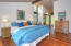 master bedroom with cathedral ceilings