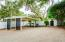 large 2 car carport + more spaces all behind electric gate