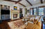 Great Room with beamed ceilings and fireplace