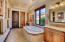 Master Bath with marble finishes, spa tub