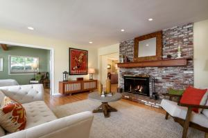 Formal living room with fireplace and hardwood floors throughout home