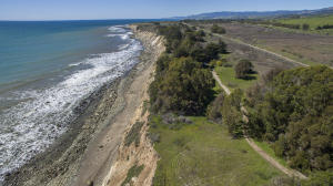 Property includes 1 mile of South-facing coastline