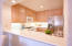 The kitchen as a breakfast bar that opens to the dining area.