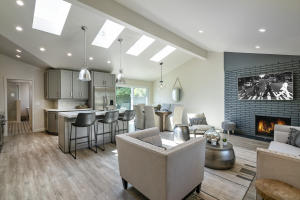 Reimagined living area anchored by an iconic, mid-century style brick fireplace.