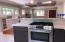 Open concept, cook and communicate with family and guests. Great home to entertain from.