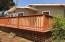 Spectacular new redwood custom deck for 275' of outdoor living with door off master.