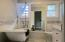 Beautiful fully remodeled bathroom with double sink, clawfoot tub w shower, custom tile work.