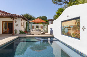 An outdoor oasis with pool, spa and 4-corner fountain feature