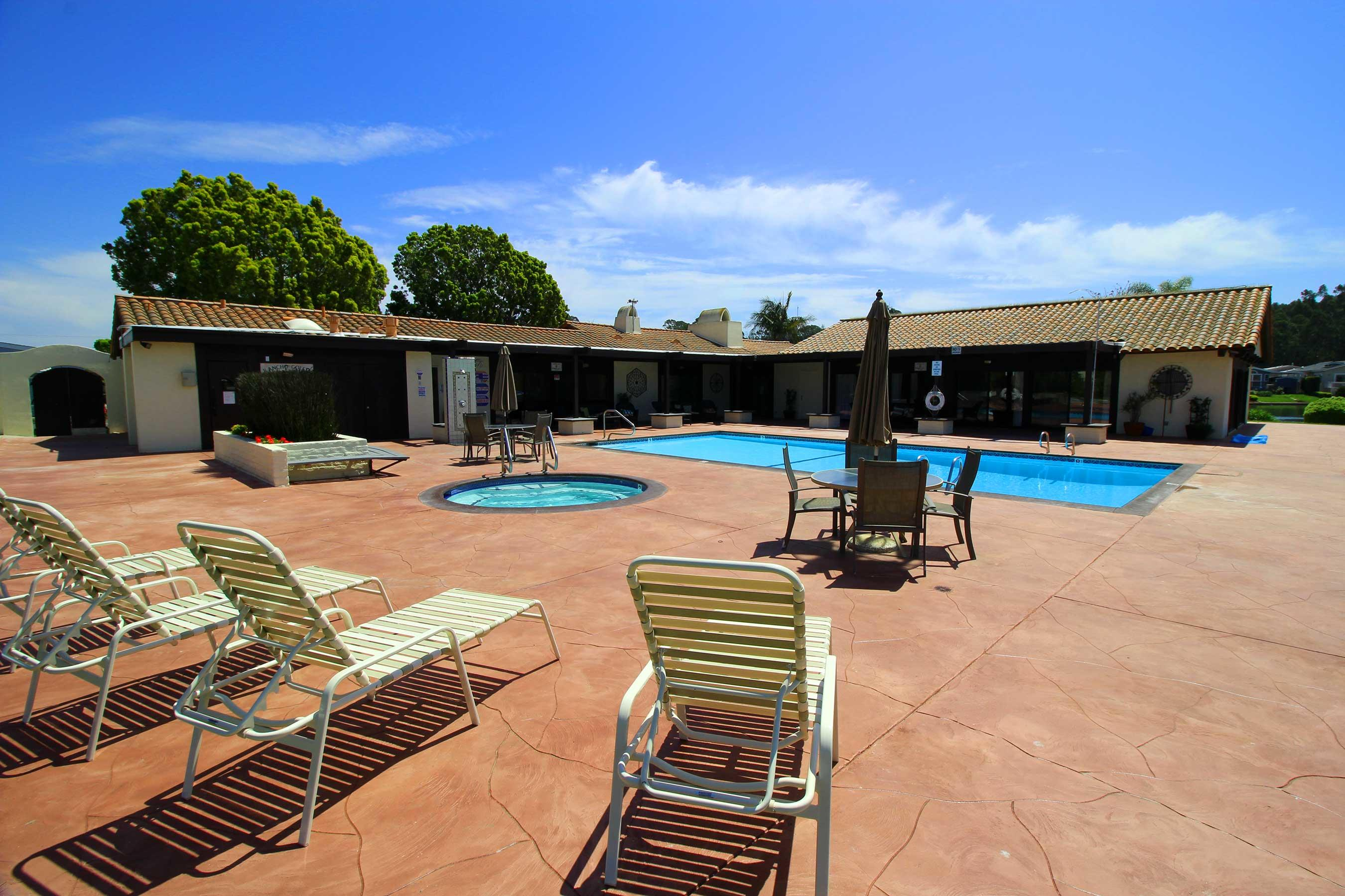 PLEASE SEE VIRTUAL TOUR VIDEO under the PHOTOS tab....  Mobile home in Resident owned Rancho Goleta Community Park; Low space rent/Association fee; New Paint, New Refrigerator, New Washer/Dryer; Mountain views seen from many large windows in the  living room; Bright and clean, this double wide 3 bedroom with 2 baths is in all ages park, It also has a nice size deck on the side to enjoy the morning sunshine. Low maintenance front and backyard has fig and lemon trees and a shed. Newer walk-in heated bathtub/spa in master bathroom. Close to Bike path, UCSB, Goleta Beach, Shopping, Restaurants, Hospital and many more. Park amenities include: Pool; Spa; Clubhouse; Gym; Lake; RV storage; and Greenbelt.