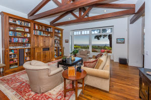 Stunning Ocean views from the living room with dark walnut floors and custom walnut entertainment center