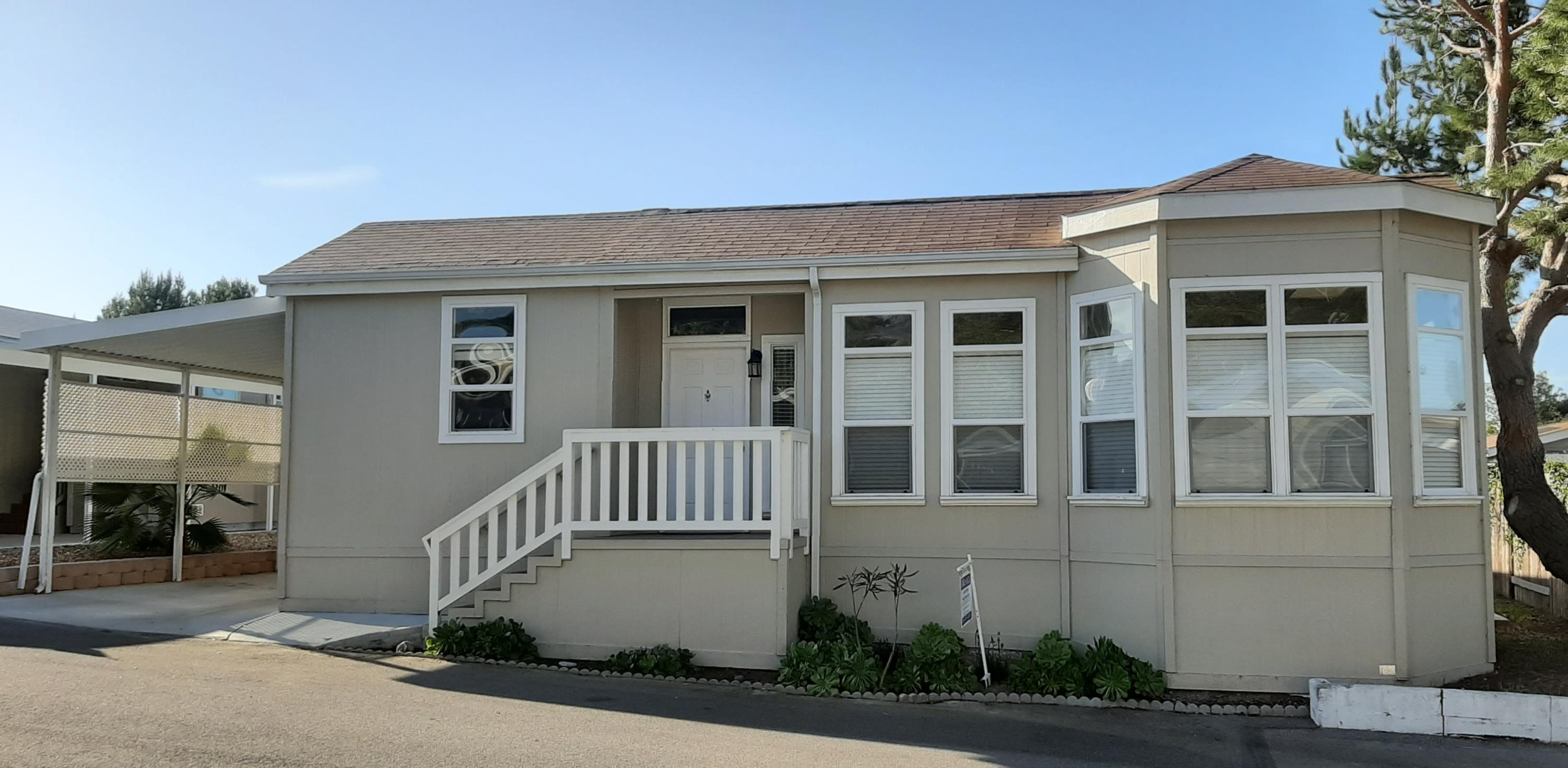 Located in the La Cumbre Mobilehome Park, this 2015 triple wide home shows like new. Appointments include Alder HW cabinets, SS appliances, 9' ceilings with transom windows, sky lights, awesome mountain views, a very large and very private back yard with patio, utility room, and is also located on a cul-de-sac making for a very private and quiet location.