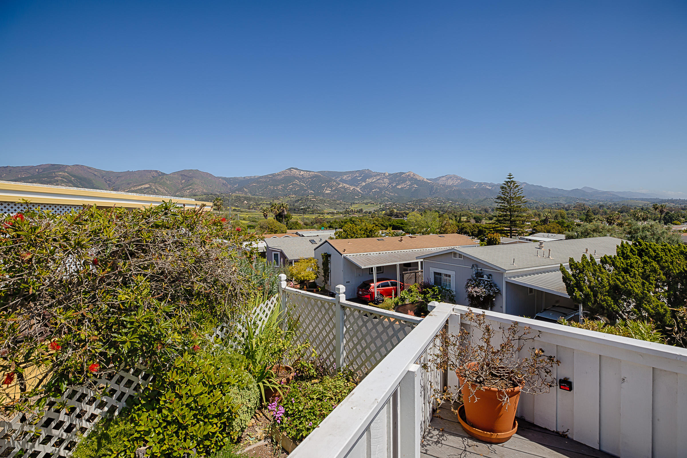 THE MOST OUTRAGEOUS views in Rancho Santa Barbara!!!  City, mountain, canyon, Hope Ranch and golf course views!  Top of the park, one of only 6 homes on ''Millionaire's Row''.  Enclosed sunroom. Living has fireplace stove and french doors to view deck. Separate dining. Large kitchen with center island. Master has large closet and bath with dual vanities. Guest bedroom and guest bath.   Laundry room.  Carport and shed. Lovely gardens.  DO NOT DISTURB OWNER. By appt. only.