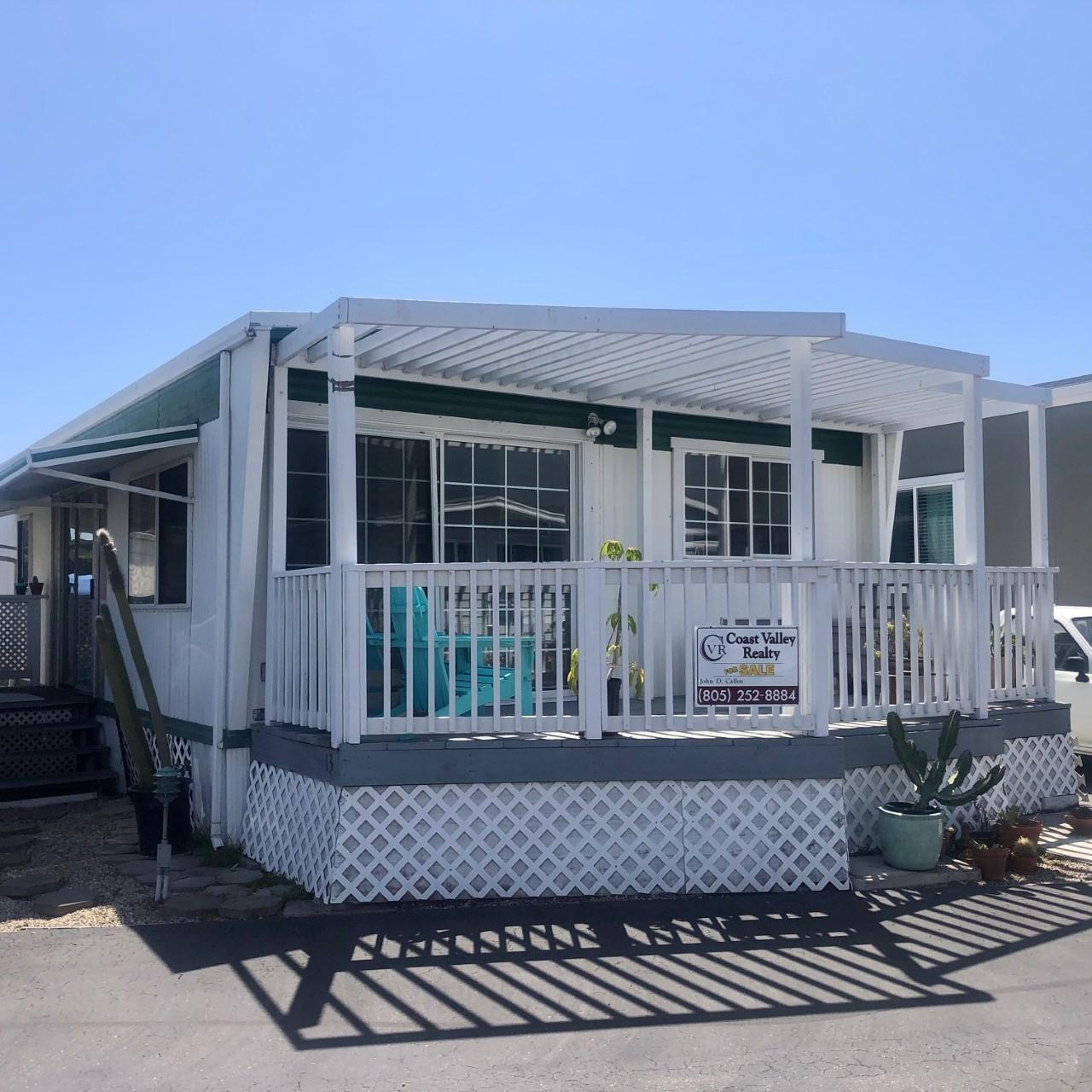 Steps to the beach, this 1966 mobile home has amazing mountain views.  Silver Sands Village is a Resident-Owned Park located on the Salt Marsh & just 2 blocks to the beach. Homeowners own the land & pay property taxes on their space.  This is a 3 bed/2 bath approx 1,080 square foot home.  Rent of $388/mo incl trash, water, mgmt.  Children, pets & guests are welcome; homes may not be rented.  Unfortunately, due to COVID-19, home is not actively being shown.   Sold ''As-Is'' due to minor exterior cosmetic updates required (paint, steps, etc).  There has been lots of  interest in replacing this unit with a new dream beach home.  Contact agent for much more info about this unique Resident-Owned Park, the replacement process and this amazing location on the Salt Marsh, just steps to the beach. Listing agent is an 18-year resident of the Silver Sands Community, a long time (former) member of the Board of Directors and has extensive experience in the sale of units as well as the purchase, financing and installation of new, custom designed homes in the community, so please inquire for more information.
