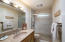 A second full bath serves two adjoining bedrooms.