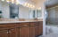 The master bath features dual sinks and granite counters.
