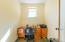 Private office with natural fiber carpeting.