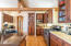 Chef's kitchen - caesar stone counters, custom cabinetry, large pantry.