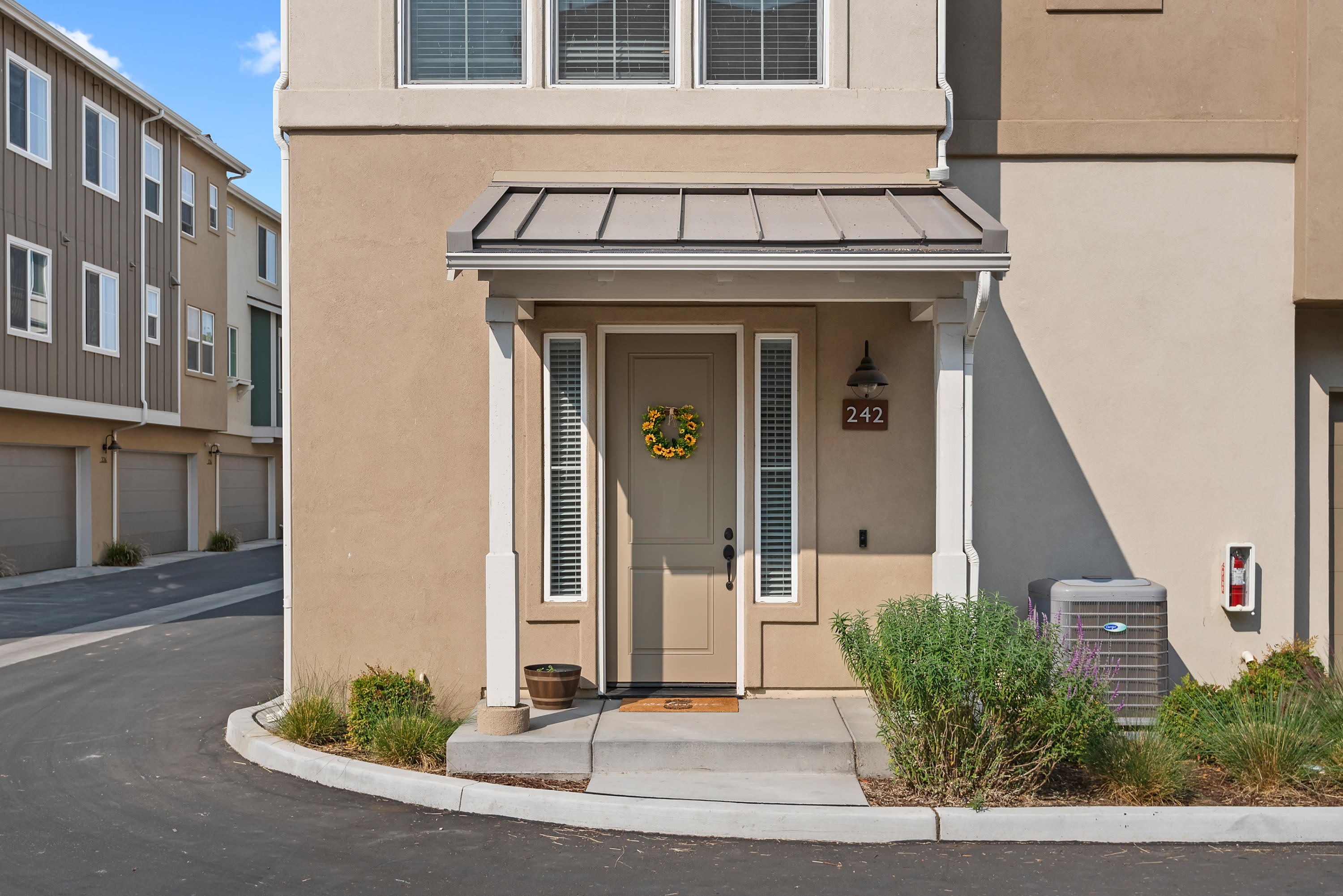 Move right in to this gorgeous Vineyard Village corner unit townhouse! Situated in the peaceful Santa Ynez Valley, Buellton offers small-town charm plus terrific value, just a short, picturesque drive to Goleta/Santa Barbara. Built in 2018, this bright & airy home feels like new construction, with an open floor plan and 9 ft ceilings throughout. The kitchen boasts quartz countertops, stainless steel appliances & 5-burner gas range. On the upper level there are 2 bedrooms, each with its own full bath. Attached 2 car garage, in-unit laundry, AC, & owned solar panels are just some of the many wonderful features of this home. Close to the 101, shopping, dining, parks & wineries- come see what makes Buellton such an appealing place to call home! Virtual tour & floor plan available 24/7.