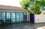 Garage Conversion has a small bathroom, small bedroom, kitchenette and living space. Access to side patio