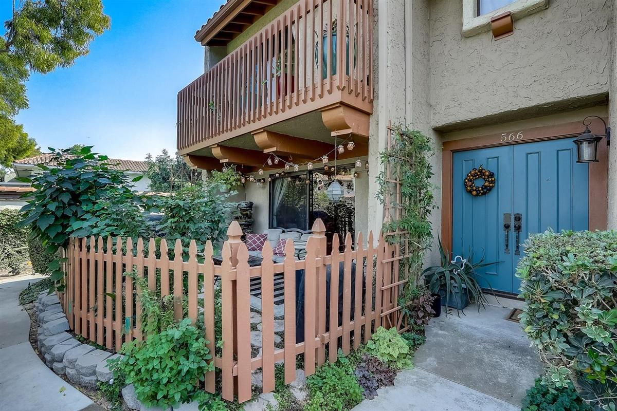 Located walking distance from shopping and restaurants, this newly remodeled end unit is ready to move in!  Greeted by a serene gated patio/garden just steps from the sparkling community pool and spa.  The mosaic tiled entryway leads to the living room with a cozy brick fire glass gas fireplace with plenty of space for entertainment. The open plan kitchen has been completely remodeled with Cambria Quartz countertops, custom soft close cabinets, new LG stainless appliances, ceramic tile flooring, a new bay window, and custom lighting.  Both master suite bathrooms have also received complete renovations including seven foot rain showerheads, Cambria Quartz countertops, new plumbing and fixtures, and custom cabinetry. Come see if this cozy updated condo can be your new oasis!