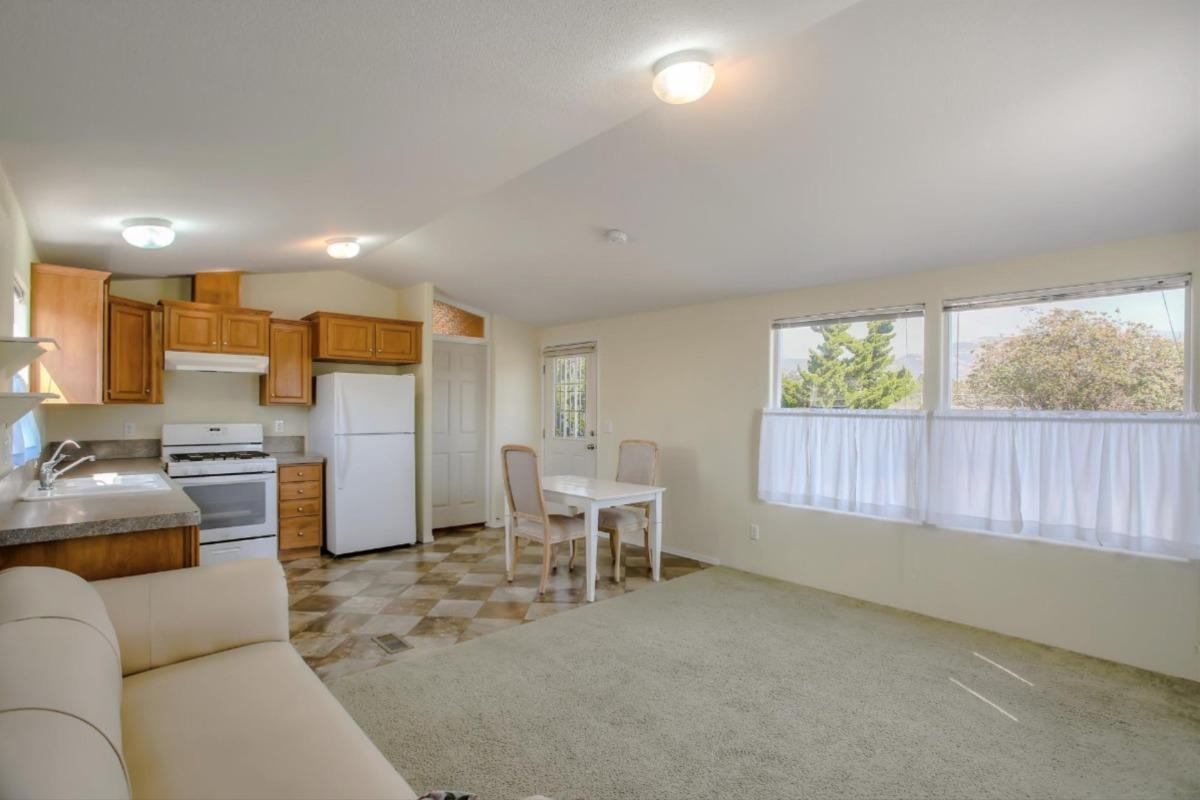 Rare opportunity to own this rarely available Rent-Controlled Manufactured Home !Escape big rent increases with this special 5-years-old, new-construction home.  With a spacious 14 x 12 master bedroom, large bathroom, and walk-in closet, this quiet, private, and multiple-parking end-unit has a fully-fenced yard (with an apricot tree and raised-bed garden), custom masonry, and a large, open-floor-plan kitchen/living room.  With excellent neighbors and a swimming-pool in the Park the many additions  including an upgraded water heater, new very-upgraded carpets, whole-house water softening, and solar heating  make this the buy of the year !