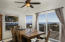 Great room of manufactured home opening to view deck